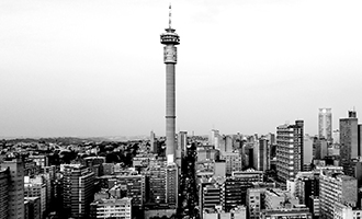 Johannesburg Skyline in black and white, overcast day with the Hilbrow Tower featured prominently in the center