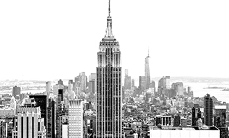 Skyline of Manhattan looking South with the Empire State Building prominently positioned in the foreground (black and white).