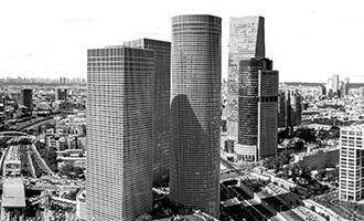 Part of Tel Aviv Skyline (in black and white). In the foreground, the Azrieli Towers Complex, and in the mid background to the right, the Sarona Tower and Africa-Israel building